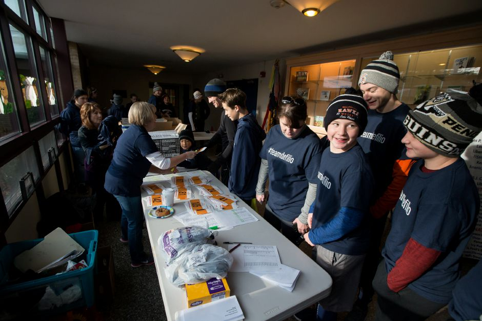 Runner and walkers register inside the school Sunday during the Kiwanis Turkey Trot 5k and 5 mile at Stephens School in Wallingford November 18, 2018 | Justin Weekes / Special to the Record-Journal