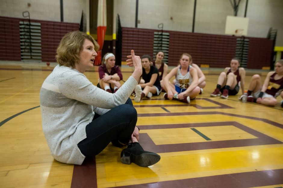 Cathy Inglese, the star player on Sheehan's 1976 state championship girls basketball team, speaks with the 2019 squad Thursday during practice at Sheehan High School. Inglese went on to a Hall of Fame career at SCSU. She's coached at the University of Vermont, Boston College, University of Rhode Island and Fairleigh Dickinson, where she is currently associate head coach.