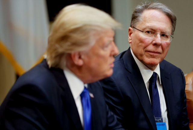 FILE - In a Feb. 1, 2017, file photo, National Rifle Associations (NRA) Executive Vice President and Chief Executive Officer Wayne LaPierre listens at right as President Donald Trump speaks in the Roosevelt Room of the White House in Washington. In the latest national furor over mass killings, the tremendous political power of the NRA is likely to stymie any major changes to gun laws. The man behind the organization is LaPierre, the public face of the Second Amendment with his bombastic...