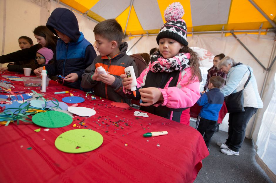 Meliah Velez 8 right makes a ornament in the craft tent Saturday during Christmas in the Village on Main Street in South Meriden December 2, 2017 | Justin Weekes / For the Record-Journal
