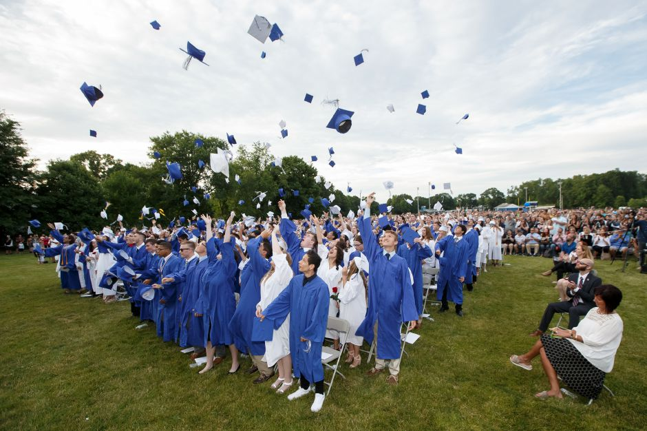 Graduated celebrate with the cap toss Friday during Lyman Hall High School