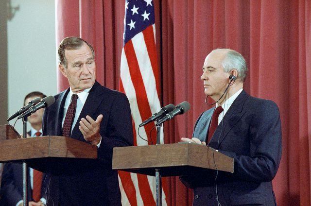 FILE - In this Oct. 29, 1991, file photo, President George H.W. Bush gestures during a joint news conference with Soviet President Mikhail Gorbachev, at the Soviet Embassy in Madrid. Bush died at the age of 94 on Friday, Nov. 30, 2018, about eight months after the death of his wife, Barbara Bush. (AP Photo/Jerome Delay, File)