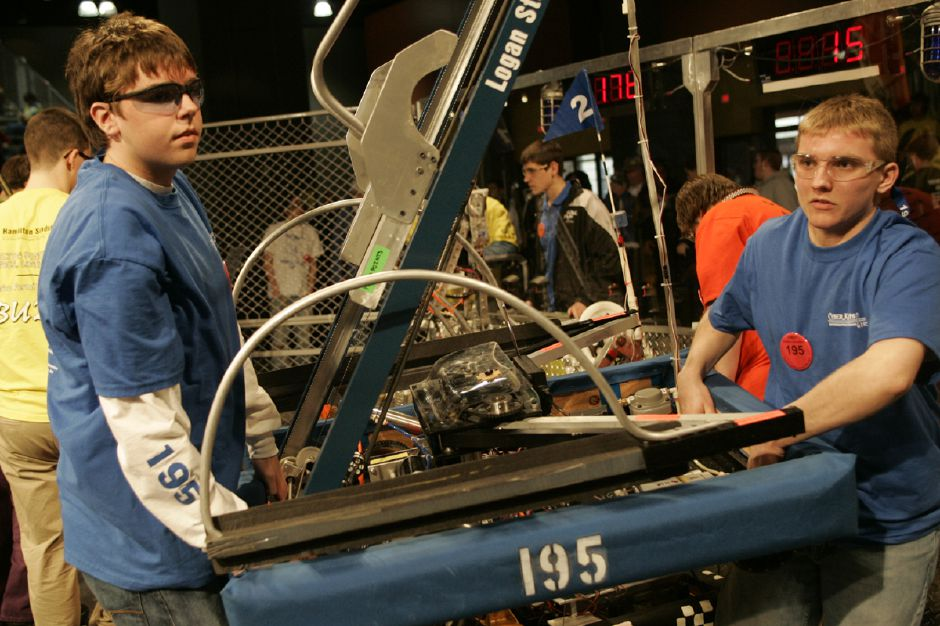 "Record Journal Photo/ Johnathon Henninger 3/14/08 left to right, Eric Gherken and Andrew Zdeblick from Southington High School remove their robot from the arean at the ""First Robotics"" Competition at the Hartford Convention Center Friday afternoon. Cheshire and Maloney High Schools also competed."