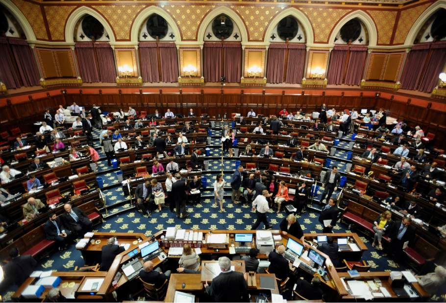 Connecticut State representatives work inside the Hall of the House at the Capitol on the final day of session, Wednesday, June 3, 2015, in Hartford, Conn. State lawmakers were spending the final hours of this year