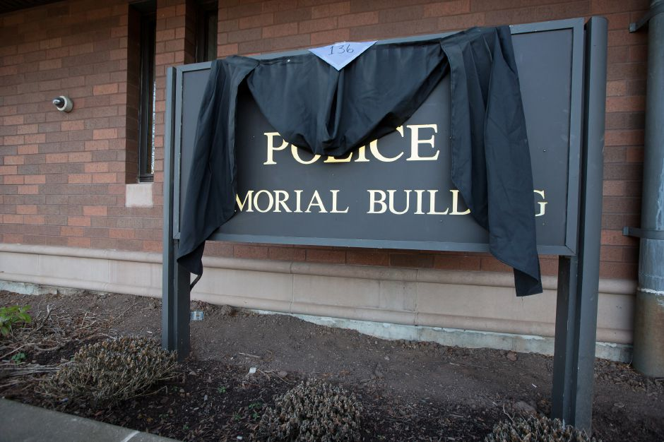 Memorial bunting is hung on the Meriden Police Department building sign for Lt. Lawrence Guidobono who died this week, Dec. 27, 2018 | Justin Weekes / Special to the Record-Journal