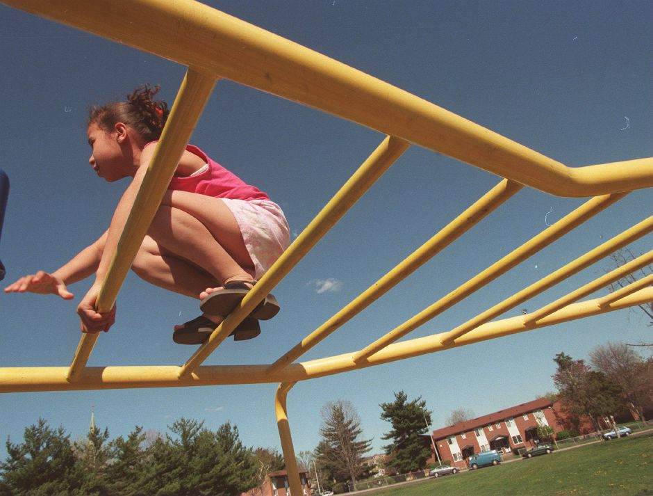 RJ file photo - Yajaira Marrero, 10, a resident of the Mills Memorial Apartments in Meriden, plays on the playscape at the Mills, May 1999.