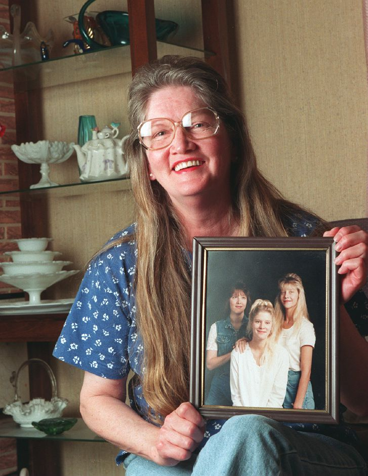 RJ file photo - Beverly Frazer of Meriden holds a picture of the triplets she gave birth to 29 years ago, May 1999.