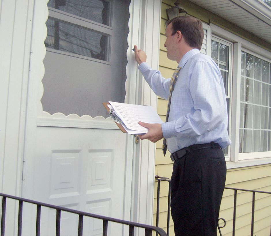 Congressman Chris Murphy knocks on the door of a Reynolds Drive home Friday afternoon, August 13, 2010. Murphy was in town to campaign for re-election and drum up support for legislation that will make more federal contracts go to American companies. (Dan Ivers / Record-Journal)