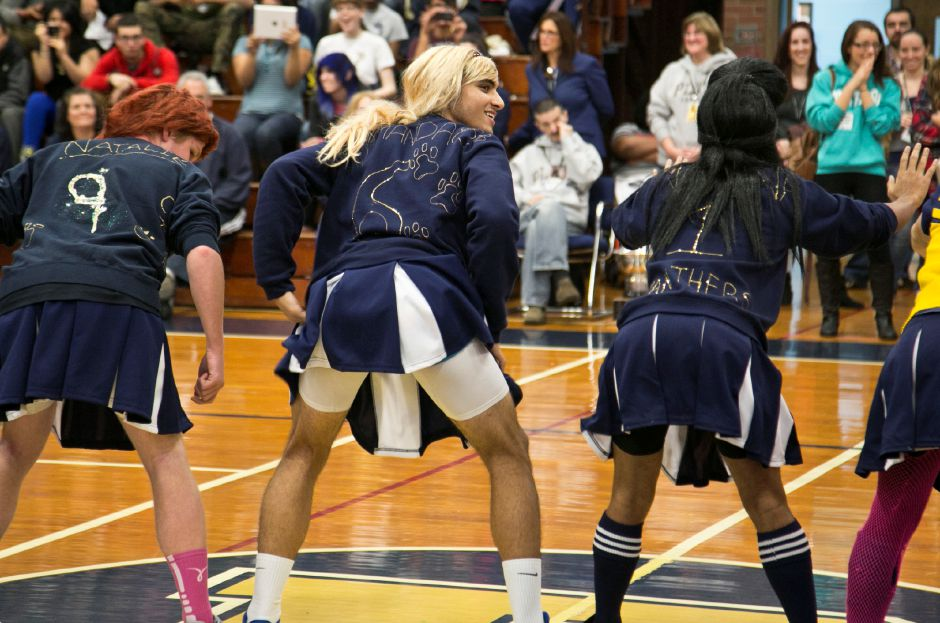 The powder puff cheerleaders twerk during their routine for the students and staff during the pep rally at Platt High School in Meriden, Nov. 27, 2013. The routine featured dance moves and acrobatics that pumped up the crowd.| Christopher Zajac / Record-Journal