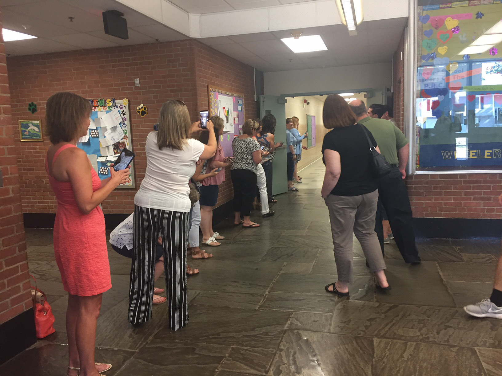 Parents wait for Plainville High School seniors to come down the hall of their old elementary school, Thursday, June 15. Linden and Toffolon participated as well in the first senior walk. |Ashley Kus, The Plainville Citizen