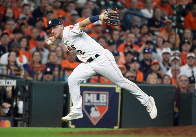 FILE - In this Oct. 4, 2019, file photo, Houston Astros third baseman Alex Bregman looks to first after fielding a grounder by Tampa Bay Rays