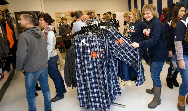 Students, staff and visitors look at merchandise in the new Packy