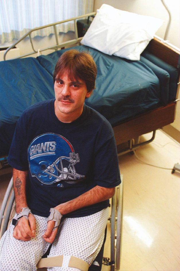 RJ file photo - John Terito, a parapelegic recovering from surgery at Gaylord Hospital, suffered a further setback when more than $1,200 worth of electronic equipment was stolen from his home, Dec. 1998.