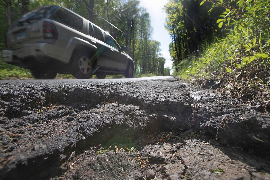 Road in need of repair along Carey Street in Southington, Wed., May 15, 2019. Dave Zajac, Record-Journal