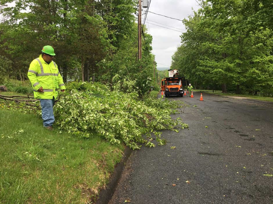 Eversource crews clear debris from the road on Wildwood Circle in Durham on Wednesday, May 16, 2018. | Lauren Takores, Record-Journal