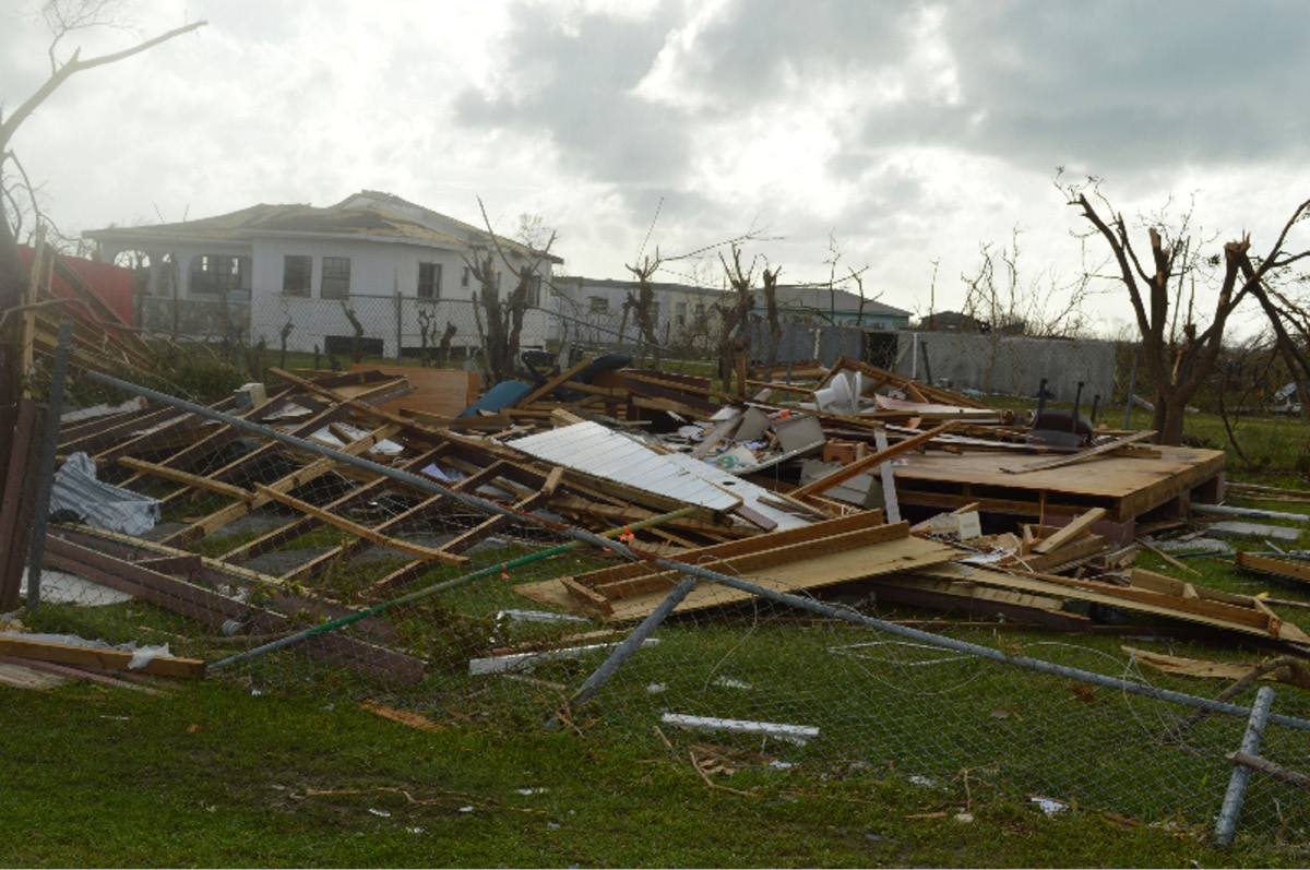 In this Thursday, Sept. 7, 2017, photo, damage is left after Hurricane Irma hit Barbuda. Hurricane Irma battered the Turks and Caicos Islands early Friday as the fearsome Category 5 storm continued a rampage through the Caribbean that has killed a number of people, with Florida in its sights. (AP Photo/Anika E. Kentish)
