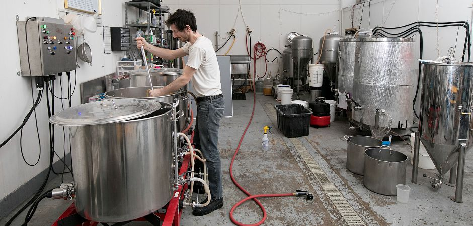 Ed Peccerillo, assistant brewer, stirs the mash at Front Porch Brewing at 226 N. Plains Industrial Rd. Unit 4 in Wallingford, Friday, Feb. 2, 2018. Dave Zajac, Record-Journal