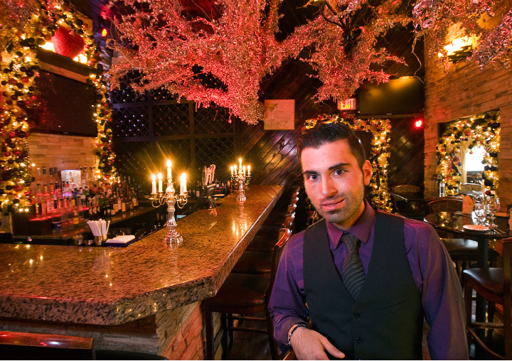 Tony Papahristou, manager, stands in the bar of Cava Restaurant in Southington Wednesday. Papahristou has designed an all new holiday display for patrons of the business, located at 1615 West St.| Dave Zajac, Record-Journal