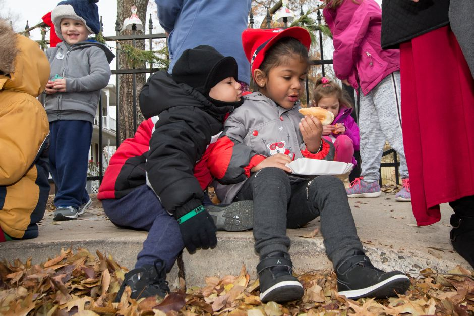 Three-year-old Esaias Shelton,  left, tries to sneak a bite of 4-year-old Zantavian Rodriguez's hotdog.