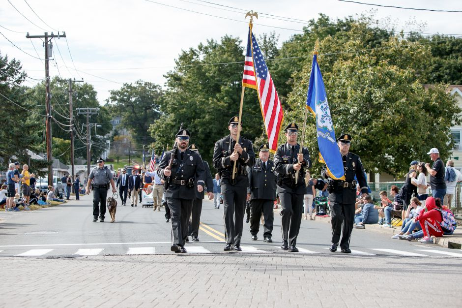 Southington Police color guard leads the way Sunday during the Southington Apple Harvest Festival Parade in Southington September 30, 2018 | Justin Weekes / Special to the Record-Journal