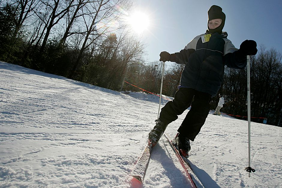 Andrew Zrosky, 12, of Southington skis down a hill at Mt Southington in Southington Christmas eve 2009. Record Journal Photo/Johnathon Henninger.