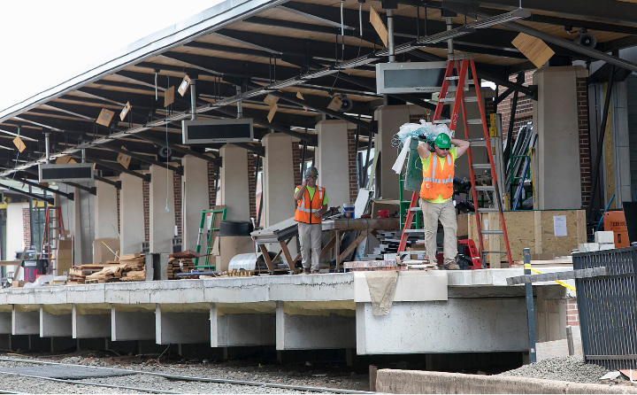 Crews continue work on the platform of the Meriden Train Station on State Street in Meriden, Wednesday, July 5, 2017. | Dave Zajac, Record-Journal