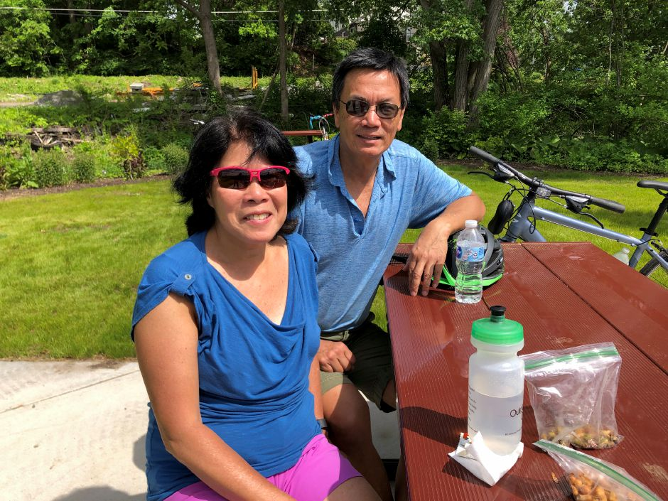 Bikers Sandra Long and Tom Long from Norwalk enjoying a picnic lunch on the Farmington Canal Heritage trail. | Kristen Dearborn, Contributed