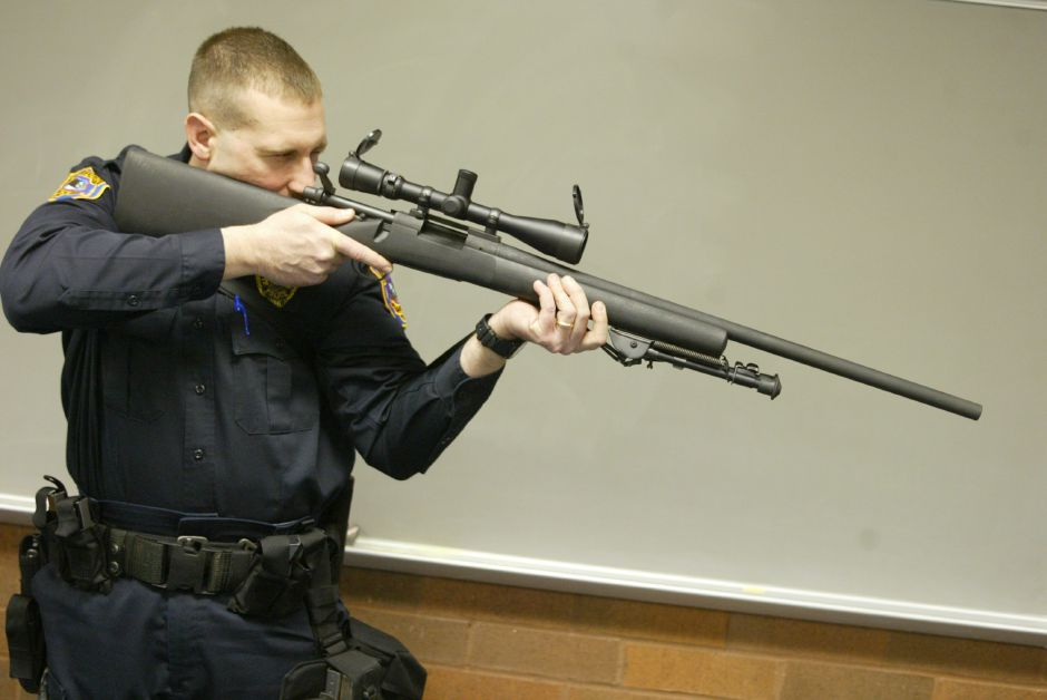 Lt. Larry Guidobono, commander of the Meriden SWAT Tactical Team, looks throught the scope of a Remington 700P bolt action sniper rifle.