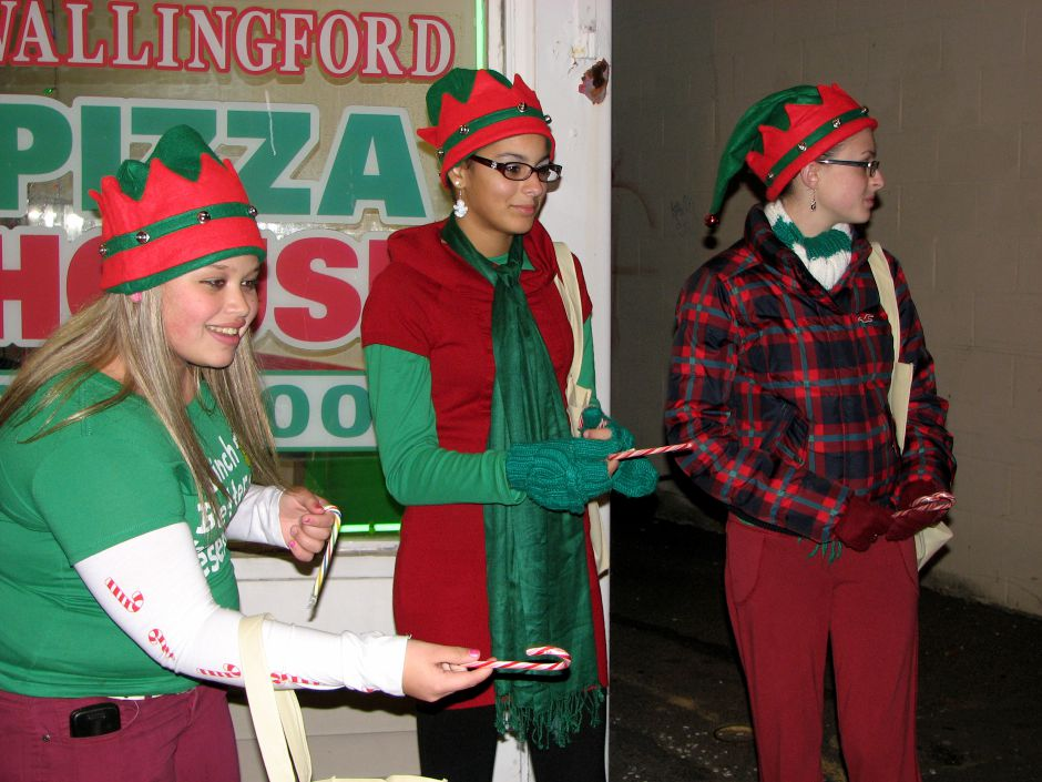 From left: Wallingford residents Paige Eliseo, Serena Cosgrove and Alexis Burgess, all 14, hand out candy canes outside Wallingford Pizza House during the Holiday Stroll in downtown Wallingford, December 2, 2011. (Russell Blair/Record-Journal)