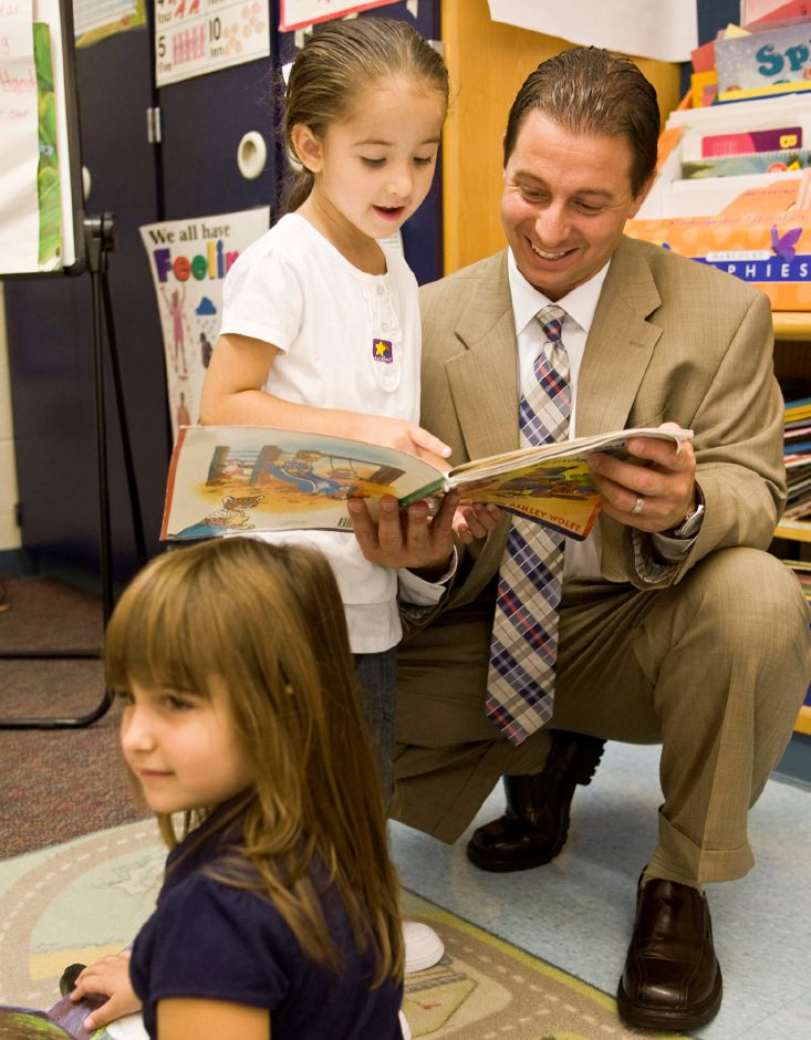 Superintendent Mark Benigni stops and meets kindergarten students at Ben Franklin School Monday morning on the first day of classes in Meriden, August 30, 2010. Benigni, starting his first year as superintendent, was visiting every public school in the district on the first day to meet students and staff. (Christopher Zajac/Record-Journal)