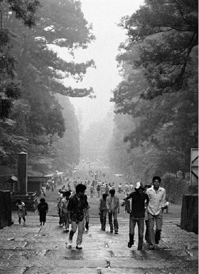 Rain or shine, Nikko, Japan is crowded with foreign and Japanese tourists on Sept. 1, 1975.  (AP Photo/ Nick Ut)