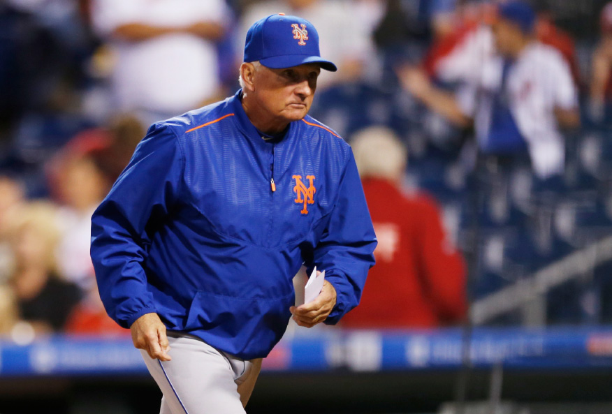 831f60893 New York Mets manager Terry Collins runs to the dugout before the start of  a baseball