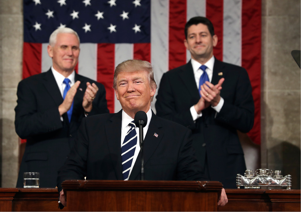 President Donald Trump, flanked by Vice President Mike Pence and House Speaker Paul Ryan of Wis., arrives on Capitol Hill in Washington, Tuesday, for his address to a joint session of Congress. | Associated Press