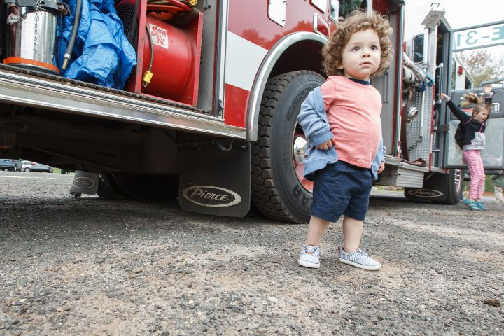 Geovanny Hidalgo 1 of Waterbury stands next to a Southington fire truck Saturday during a Touch a Truck event at the Southington Drive In May. 9, 2015 | Justin Weekes / For the Record-Journal