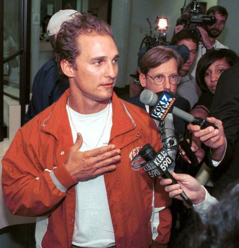 Actor Matthew McConaughey, 29, left, is swamped by reporters at the municipal courthouse in Austin, Texas, on Monday, Oct. 25, 1999, after being released from police custody. The 29-year-old actor was charged with resisting transportation Monday, Oct. 25, 1999, after being arrested at his home in the early hours of the morning. The misdemeanor carries a maximum sentence of a year in county jail and a $4,000 fine. (AP Photo/Jack Plunkett)