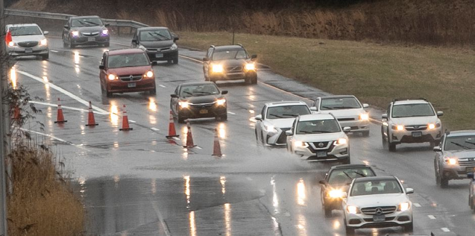 Traffic cones divert motorists around flood waters on Route 15 south in Meriden, Fri., Dec. 21, 2018. Dave Zajac, Record-Journal