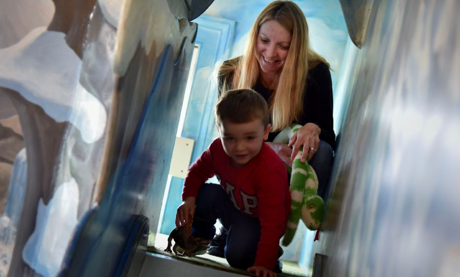 Southington resident Heather Baker plays with her son, Tyler, 3, at Kidcity in Middletown  on Tuesday. The children