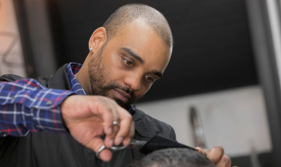 Barber Trey Maestri, owner of Trey's Barbershop, cuts the hair of customer Bryan Sola, of Southington, at the new business on Center Street in Southington, Wednesday morning, February 21, 2018. Dave Zajac, Record-Journal