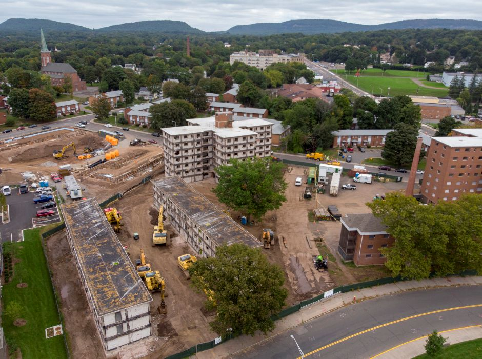 Demolition of the Mills Memorial Apartments continues Sept. 24, 2018 in the foreground as construction of the Meriden Commons II takes place in the background. | Richie Rathsack, Record-Journal