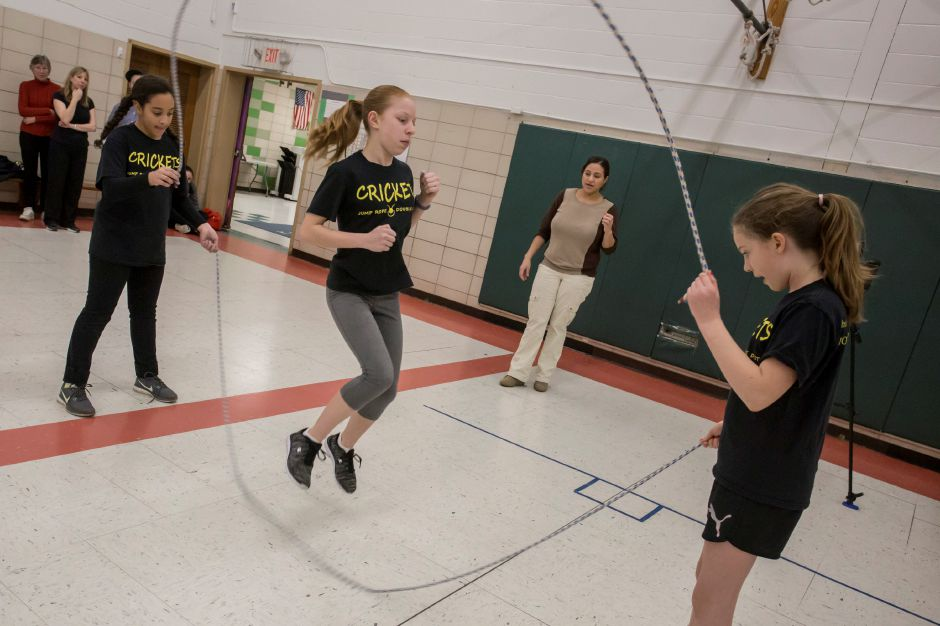 Valerie Sprague concentrates on the jump during a Crickets double dutch practice at Kelley School in Southington Feb. 27, 2018. | Richie Rathsack, Record-Journal staff