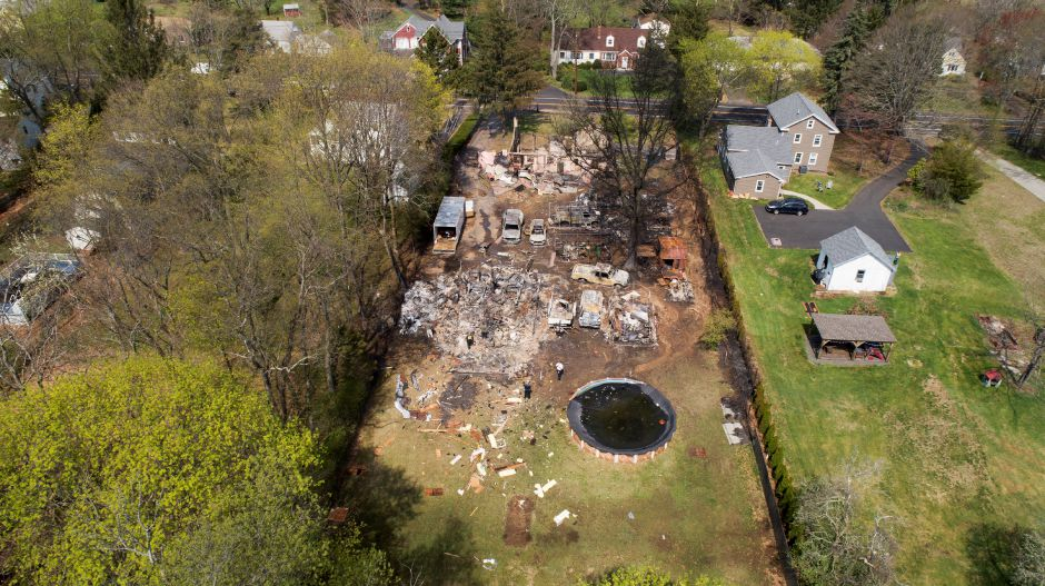 North Haven, CT 05/03/18 Authorities made a gruesome discovery early Thursday when they found remains in a structure burned following an explosion that capped an hours-long attempt by officers to coax a barricaded man from the North Haven property. (John Woike/Hartford Courant via AP)