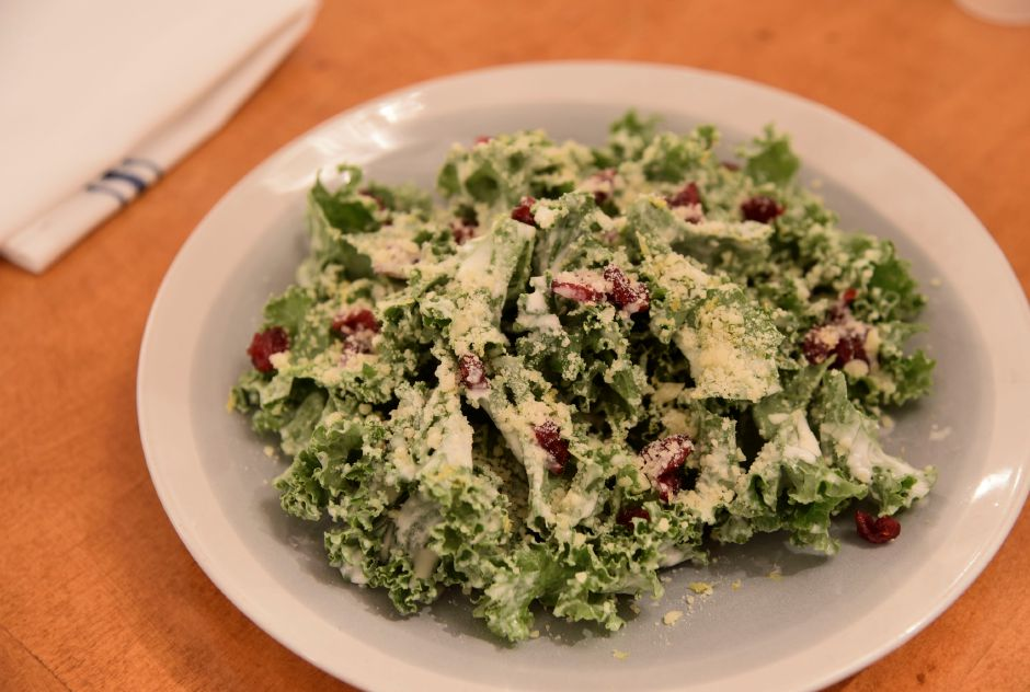 The kale salad with dried cranberries, lemon zest, parmesan cheese and buttermilk dressing, offered at Kala Bistro in North Haven, on Thursday, Dec. 6, 2018. | Bailey Wright, Record-Journal