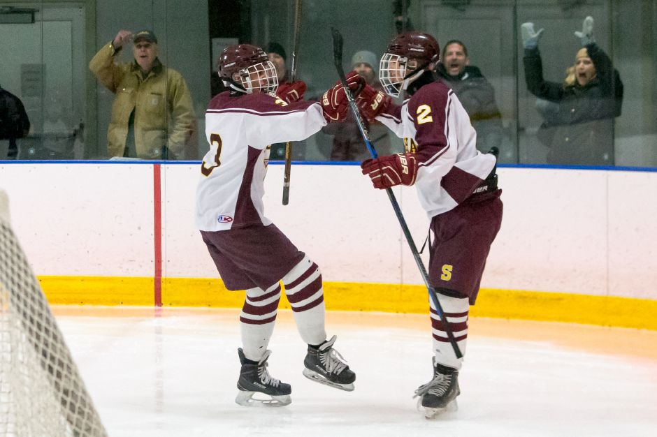 Goal celebrations were a common sight Wednesday night for the Sheehan hockey team, which exploded for 12 goals against JBWA at the Danbury Ice Arena. The 12 goals are a Sheehan program record. | Justin Weekes / Special to the Record-Journal