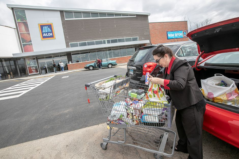 Aniela Kudewicz, of Meriden, packs groceries into her car after shopping at the newly expanded Aldi in Wallingford on Friday. Photos by Dave Zajac, Record-Journal