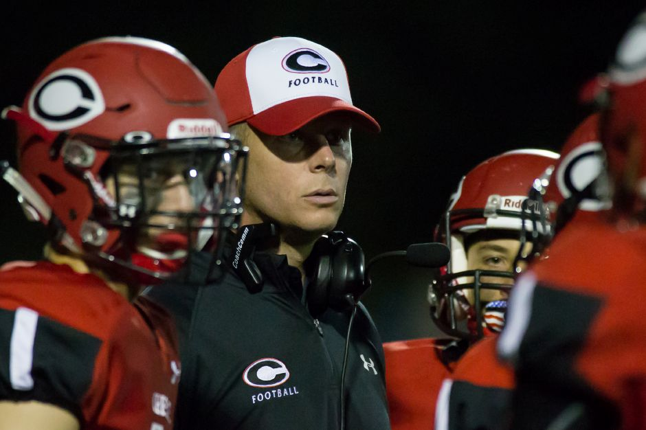 Game Face: Coach Don Drust and his Cheshire Rams had theirs on Friday night in West Haven, where a goal-line stand in the closing minute preserved a 21-14 victory over the Blue Devils. It was the first win of the season for Cheshire. | Justin Weekes / For the Record-Journal
