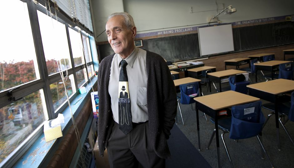Dom Forino reflects on 50 years of teaching while in his  classroom at Holy Trinity School in Wallingford on Wednesday. Forino teaches math and  science to 8th-graders. Dave Zajac, Record-Journal