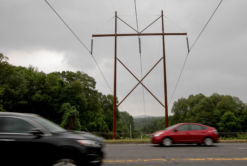 Power lines cross West Street in Southington, Friday, June 23, 2017. Eversource workers on ATV's will be inspecting transmission lines in rights-of-way this summer as part of preventative maintenance and tree trimming. | Dave Zajac, Record-Journal