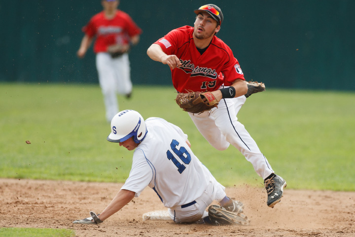 Southington's Michael Taylor (16) slides into second as Fairfield's Michk Nardone (19) jumps over him Tuesday at Muzzy Field in Bristol  June,10 2014 | Justin Weekes / For the Record-Journal