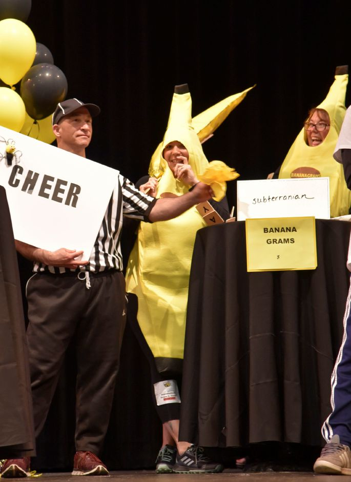 "Referee Steve Blumenthal throws a flag on team ""Bananagrams"" after they spell a word wrong, during the North Haven Education Foundation"