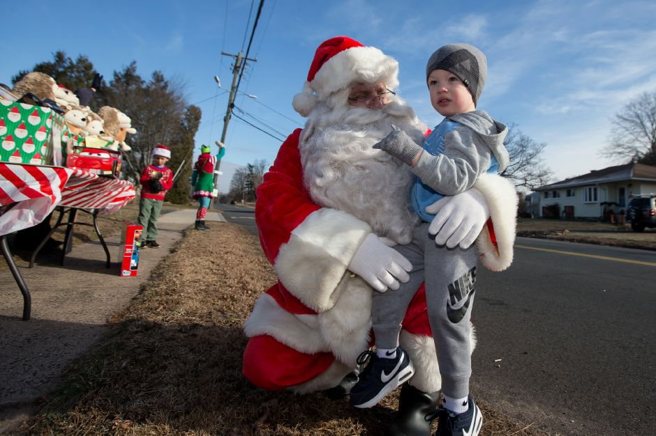 Landon Parciak 2 of Southington visits with Santa Sunday during the 5th Annual Valerie